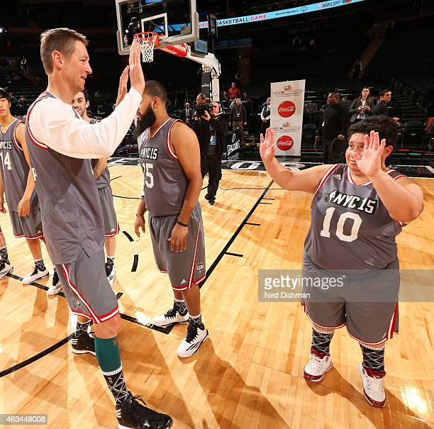 Former NBA Player Detlef Schrempf high fives a teammate during NBA Cares Special Olympics Unified Sports Game as part of 2015 AllStar Weekend at...
