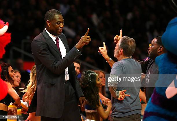 Former NBA player Dikembe Mutombo and TV personality Jon Stewart dance on court in the Foot Locker ThreePoint Contest during NBA AllStar Weekend 2016...