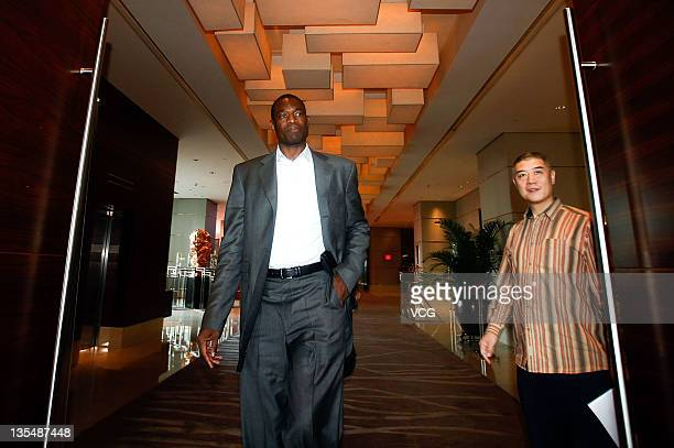 Former NBA player Dikembe Mutombo attends a press conference to promote the 2011 2012 NBA Season at Westin Hotel on December 11 2011 in Guangzhou...