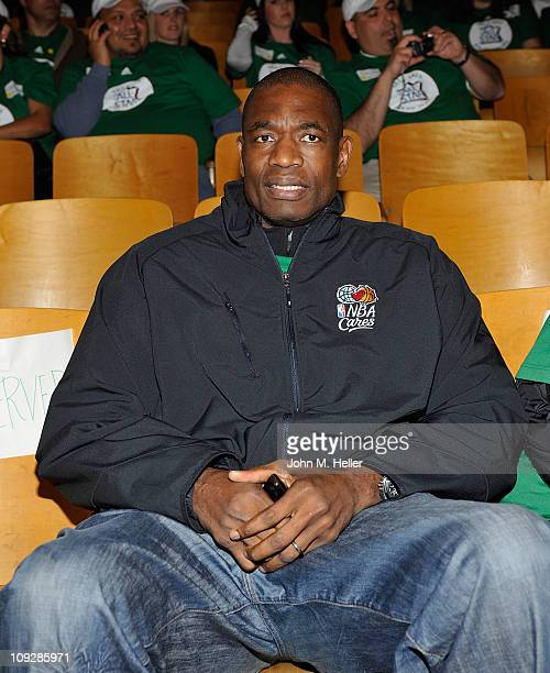 Former NBA player Dikembe Mutombo attends the NBA Cares AllStar Day of Service with City Year at Virgil Middle School on February 18 2011 in Los...