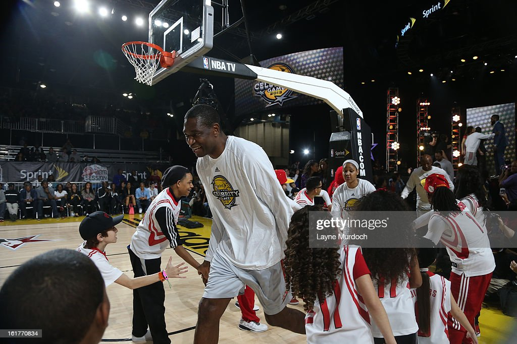 Former NBA player Dikembe Mutombo of the West Team is introduced prior to the Sprint Celebrity Game at Jam Session during NBA All Star Weekend on February 15, 2013 at the George R. Brown in Houston, Texas.
