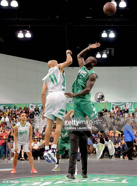 Former NBA player Doug Christie and professional boxer Deontay Wilder participate in the Sprite celebrity basketball game during the 2015 BET...