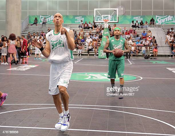 Former NBA player Doug Christie and recording artist Chris Brown participate in the Sprite celebrity basketball game during the 2015 BET Experience...