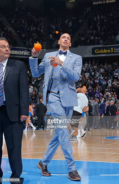 Former NBA player Doug Christie tosses out mini basketballs to fans during the game between the Oklahoma City Thunder and Sacramento Kings on April 9...