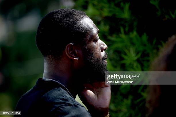 Former NBA player Dwyane Wade of the Miami Heat pays his respects at the memorial site for victims of the collapsed 12-story Champlain Towers South...