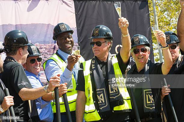 Former NBA player Earvin 'Magic' Johnson actor Will Ferrell and Senior Partner at Apollo Global Management Larry Berg attend the Los Angeles Football...