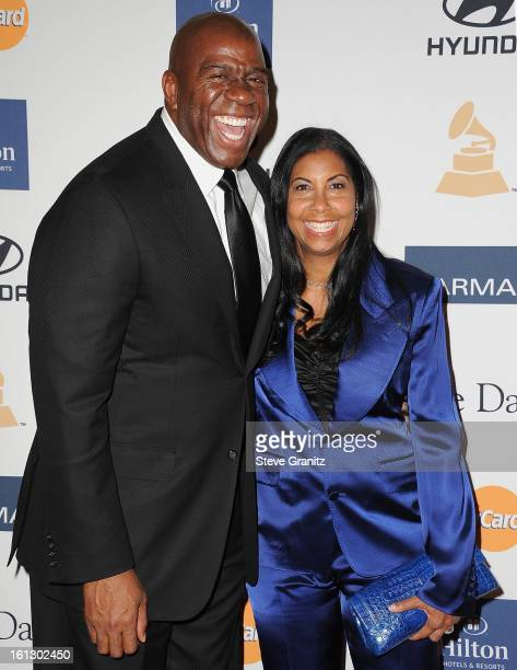 Former NBA player Earvin Magic Johnson and Cookie Johnson arrive at the 55th Annual GRAMMY Awards PreGRAMMY Gala and Salute to Industry Icons...