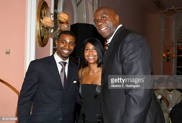 Former NBA player Earvin 'Magic' Johnson his wife Cookie and their son Andre Johnson attend the USA TODAY Hollywood Hero honoring Magic Johnson at...