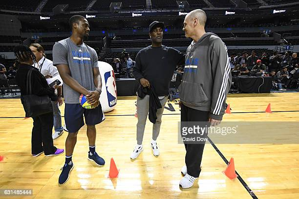 Former NBA player Gary Payton and Harrison Barnes and Rick Carlisle of the Dallas Mavericks participate in a NBA Cares Unified Basketball Clinic...