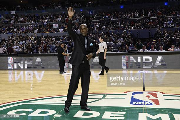 Former NBA player Gary Payton waves to crowd during the San Antonio Spurs game against the Phoenix Suns as part of NBA Global Games at Arena Ciudad...