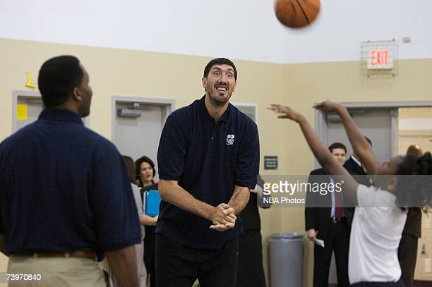 Former NBA player George Muresan encourages a student during Malaria Awareness Day at Friendship Public Charter School on April 25 2007 in Washington...
