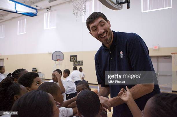 Former NBA player George Muresan is mobbed by students during Malaria Awareness Day at Friendship Public Charter School on April 25 2007 in...