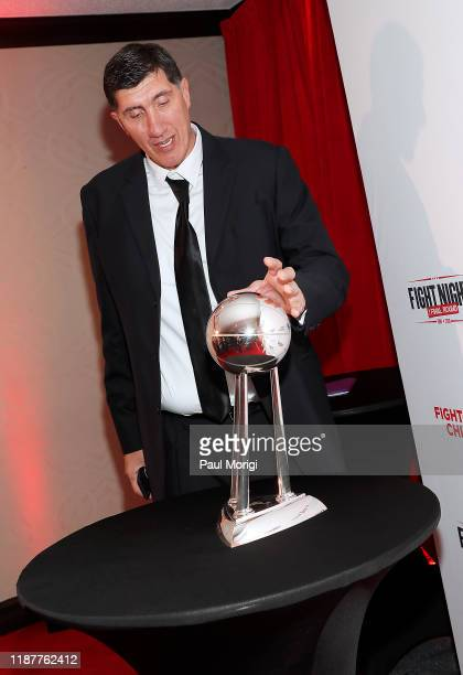 Former NBA player Gheorghe Muresan with the Washington Mystics WNBA Championship trophy at the 30th Annual Fight Night: The Final Round at the...