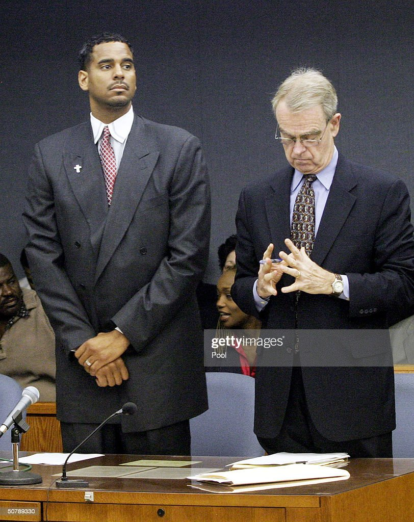 Former NBA player Jayson Williams (L) and his attorney Joseph Hayden Jr. stand while the jury enters the courtroom for readbacks during Williams' manslaughter trail with his defense attorneys Billy Martin (L) and Joseph A. Hayden Jr. at the Somerset County Courthouse April 30, 2004 in Somerville, New Jersey. Williams was acquitted of the most serious charge of aggravated manslaughter in the shooting death of Costas 'Gus' Christofi. He was found guilty on four counts, hindering apprehension or prosecution, tampering with evidence, tampering with a witness and fabricating evidence and the jury could not reach a verdict on a reckless manslaughter charge.