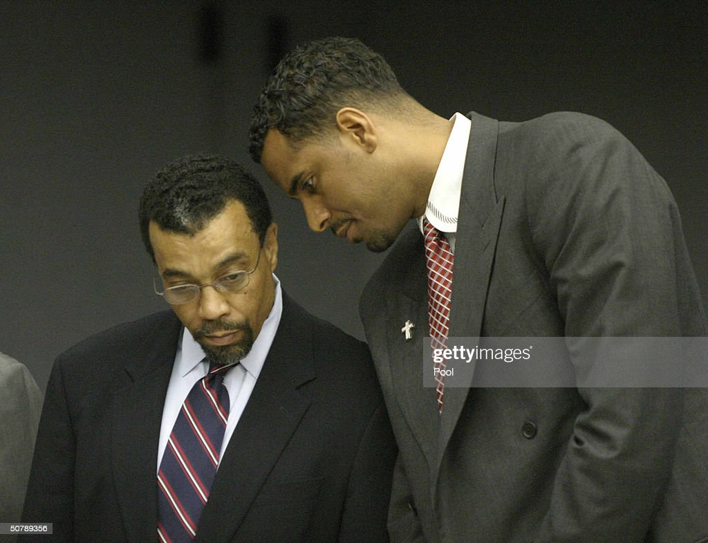 Former NBA player Jayson Williams (R) talks with defense attorney Billy Martin as the jury foreman reads the verdicts in Williams' manslaughter trial at the Somerset County Courthouse April 30, 2004 in Somerville, New Jersey. Williams was acquitted of the most serious charge of aggravated manslaughter in the shooting death of Costas 'Gus' Christofi. He was found guilty on four counts, hindering apprehension or prosecution, tampering with evidence, tampering with a witness and fabricating evidence and the jury could not reach a verdict on a reckless manslaughter charge.