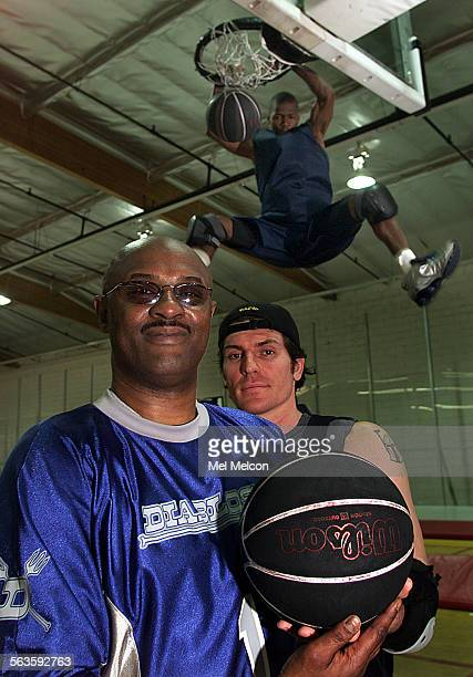 Former NBA player Joe Jellybean Bryant left is the coach of a basketball team called the Diablos that is part of Slamball league to be televised on...