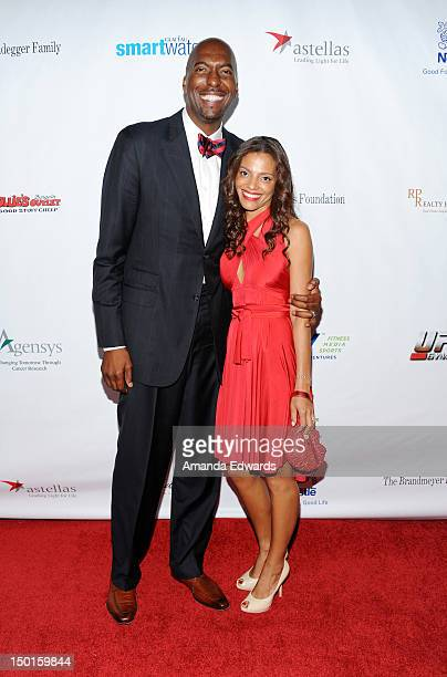 Former NBA player John Salley and his wife Natasha Duffy arrive at the 12th Annual Harold Pump Foundation Gala on August 10 2012 in Los Angeles...