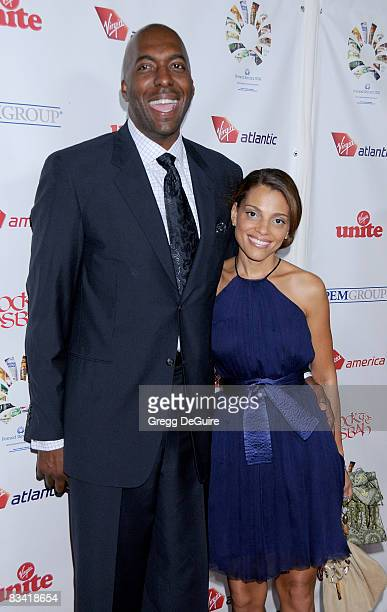 Former NBA player John Salley and wife arrive at the Sir Richard Branson Charity Event at The Roosevelt Hotel on October 23 2008 in Hollywood...