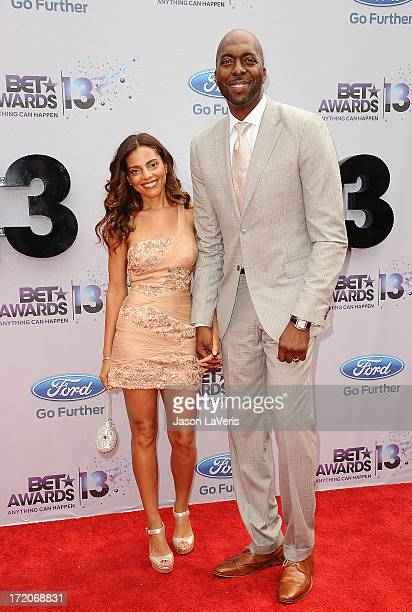 Former NBA player John Salley and wife Natasha Duffy attend the 2013 BET Awards at Nokia Theatre LA Live on June 30 2013 in Los Angeles California