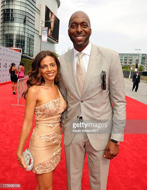 Former NBA player John Salley and wife Natasha Duffy attend the Ford Red Carpet at the 2013 BET Awards at Nokia Theatre LA Live on June 30 2013 in...