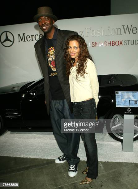 Former NBA player John Salley and wife pose at the Christian Audigier Fall 2007 fashion show during Mercedes Benz Fashion Week held at Smashbox...