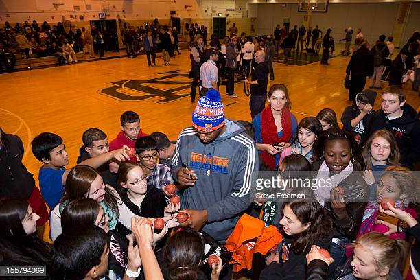 Former NBA player John Wallace signs autographs at New Dorp High School as part of NBA Cares New York Knicks Hurricane Sandy Relief Efforts on...
