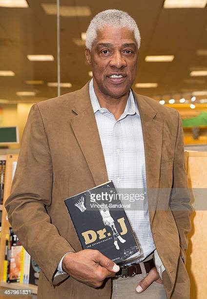 Former NBA player Julius Erving signs copies of his memoir Dr J The Autobiography at Barnes Noble bookstore at The Grove on December 19 2013 in Los...