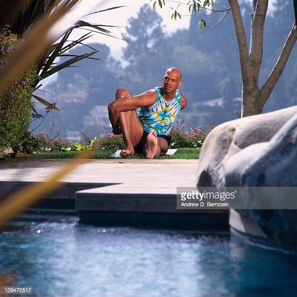 Former NBA Player Kareem AbdulJabbar practices yoga during a photo shoot circa 1996 in Los Angeles California NOTE TO USER User expressly...