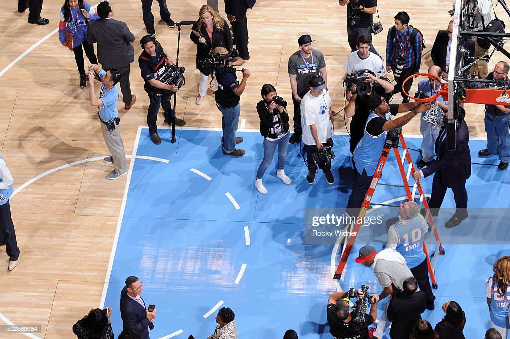 Former NBA player Kenny Thomas cuts a piece of the net after the final game at Sleep Train Arena between the Oklahoma City Thunder and Sacramento Kings on April 9, 2016 at Sleep Train Arena in Sacramento, California.