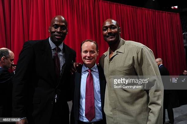 Former NBA player Kevin Willis Head Coach of the Atlanta Hawks Mike Budenholzer and hall of famer Karl Malone attend the Dominique Wilkins Statue...