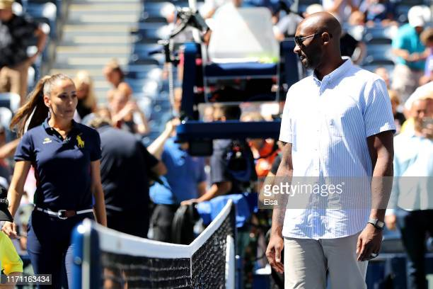 Former NBA player Kobe Bryant looks on prior to the coin toss for the Men's Singles third round match between Roger Federer of Switzerland and Daniel...