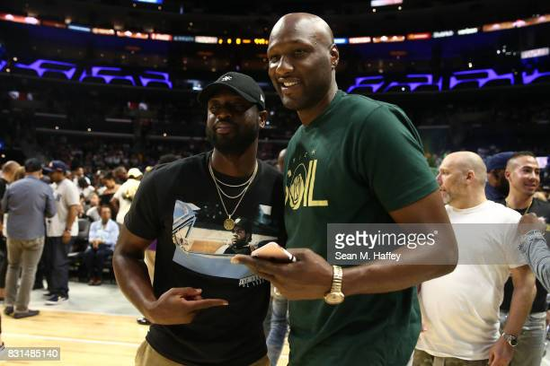 Former NBA player Lamar Odom and NBA player Dwyane Wade attend week eight of the BIG3 three on three basketball league at Staples Center on August 13...
