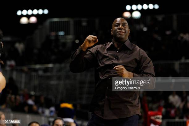 Former NBA Player Magic Johnson and West Head Coach Magic Johnson pumps his fist during the BBVA AllStar Celebrity Game on center court at Jam...