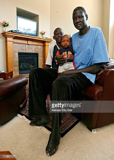 Former NBA player Manute Bol sits in his Olathe Kansas home with his two sons Bol Bol and Madut Bol Tuesday July 17 2007