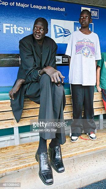 Former NBA player Manute Bol with his son Bol Bol was honored by the Kansas City Royals in the Buck O'Neil Legacy Seat for his work with Sudanese...