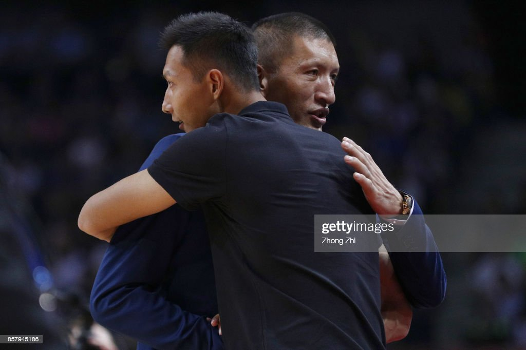 Former NBA player Mengke Bateer and Yi Jianlian hug during the game between the Minnesota Timberwolves and the Golden State Warriors as part of 2017 NBA Global Games China at Universidade Center on October 5, 2017 in Shenzhen, China.
