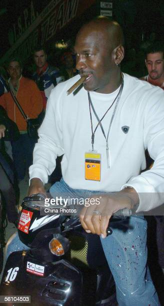 Former NBA player Michael Jordan rides a motorcycle ahead of the Spainish Motorcycling Grand Prix on November 5, 2005 in Cheste of Spain. The Spanish...