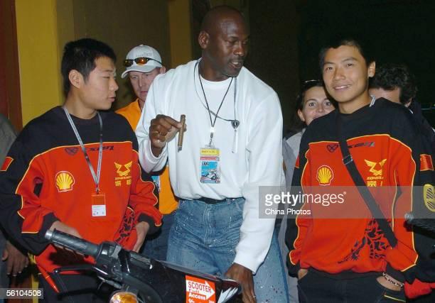 Former NBA player Michael Jordan talks with Li Zhengpeng and Wang Zhu of China and Zongshen Team, ahead of the Spainish Motorcycling Grand Prix on...