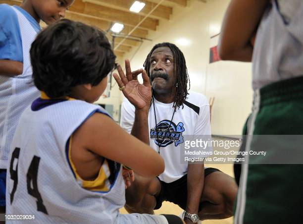 BEACH CALIF USA Former NBA player Mike Davis works with youngsters on the first day of the Pete Davis Legends Basketbal Camp at the Alpert JCC in...