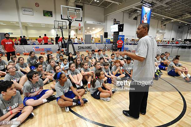 Former NBA player Muggsy Bogues instructs kids during the Jr NBA Day as part of 2016 AllStar Weekend at NBA Centre Court of the Enercare Centre on...