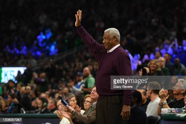 Former NBA player Oscar Robertson waves to the crowd during the first half of a game between the Milwaukee Bucks and the Philadelphia 76ers at Fiserv...