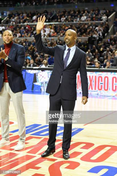 Former NBA player Richard Hamilton greets the crowd during halftime of the game between the Dallas Mavericks and the Detroit Pistons on December 12...