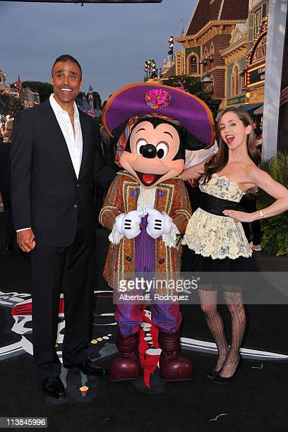 Former NBA player Rick Fox Mickey Mouse and actress Eliza Dushku arrive at the world premiere of 'Pirates Of The Caribbean On Stranger Tides' at...