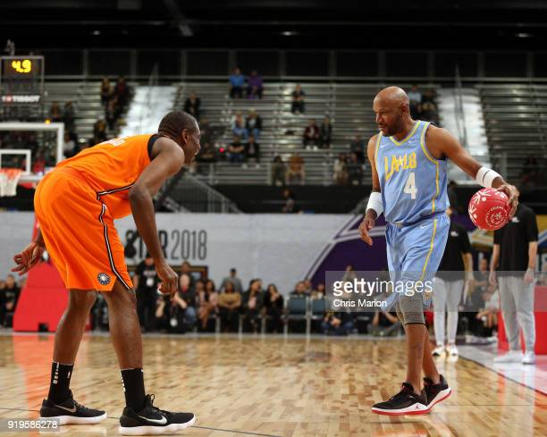 Former NBA player Ron Harper dribbles against Dikembe Mutombo during the 2018 NBA Cares Unified Basketball Game as part of 2018 NBA AllStar Weekend...