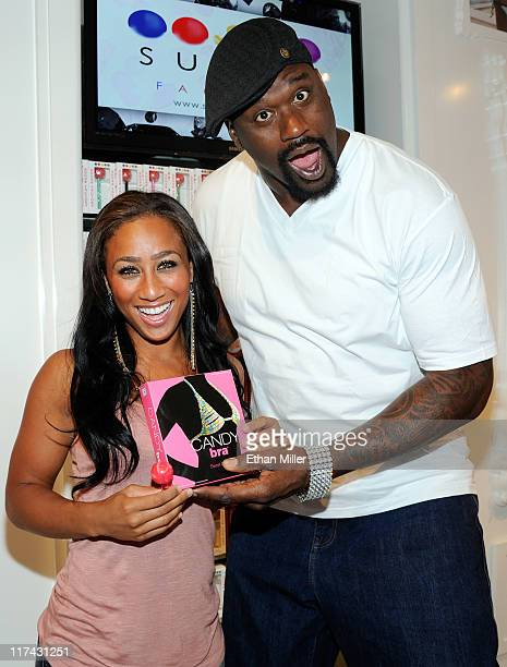 Former NBA player Shaquille O'Neal and television personality Nicole Hoopz Alexander joke around at the Sugar Factory American Brasserie at the Paris...