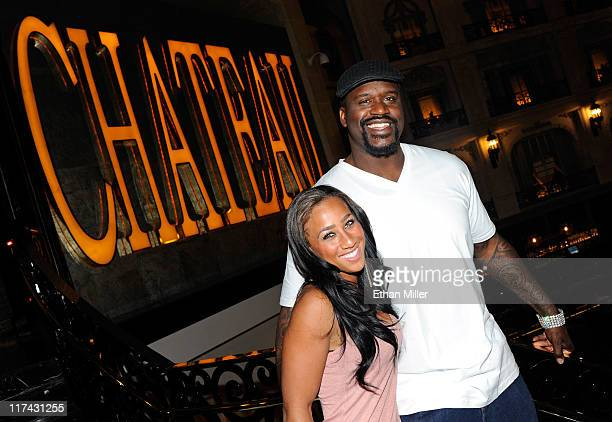 Former NBA player Shaquille O'Neal and television personality Nicole Hoopz Alexander appear outside the Chateau Nightclub Gardens while visiting the...