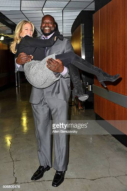 Former NBA player Shaquille O'neal holds up Lakers' owner and president Jeanie Buss during the 12th Annual Lakers AllAccess at Staples Center on...
