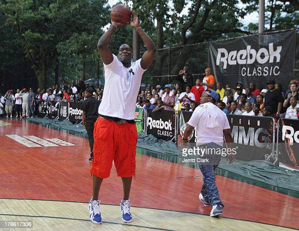 Former NBA Player Shawn Kemp shoots around at the Reebok Classic Kamikaze launch during the EBC Championship at Rucker Park on August 15 2013 in New...
