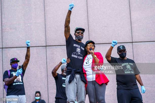 TOPSHOT Former NBA player Stephen Jackson and friends speak and raise their fists during the protest for Justice for George Floyd outside the...