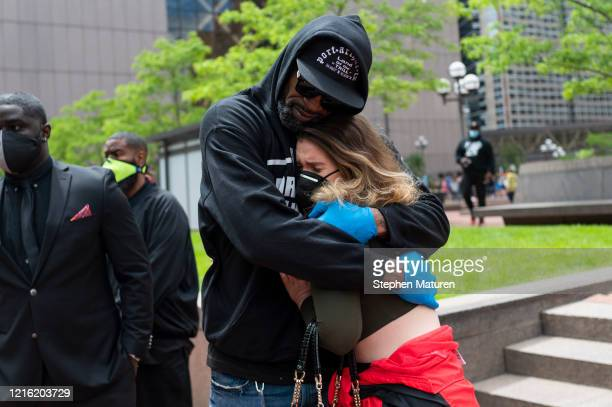 Former NBA player Stephen Jackson hugs a woman after speaking at a protest outside the Hennepin County Government Center on May 29 2020 in...